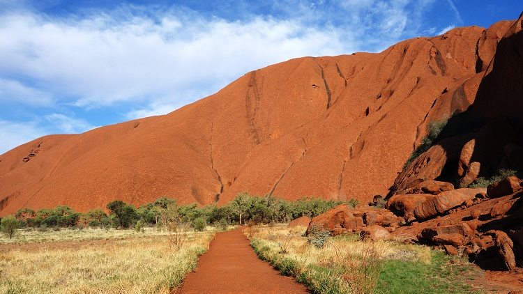 Follow the path along Uluru (Ayers Rock) to admire its beautiful colour