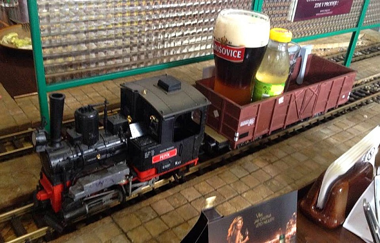 Drinks being served by trains in the Vytopna Restaurant