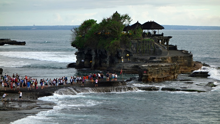 The reality of high season at the Tanah Lot Temple in Bali, Indonesia